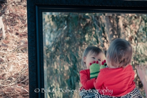 Baby-in-mirror-with-toy